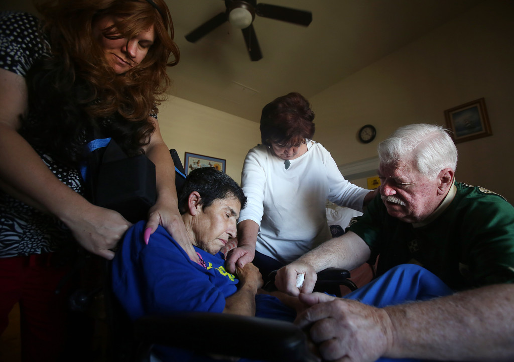 Toby Van Skike, far right, leads a prayer with Jenny Beals, far left, and Sue Pennington, second from right, for Fran Cappadocia, at the end of his visit with Cappadocia at the Arizona State Veteran Home on Wednesday May 06, 2015. Van Skike was wounded on April 26, 1968 while serving in the Vietnam War, Cappadocia was his nurse. After returning to the United States, Van Skike never forgot the nurse who cared for him. Four months ago, Van Skike found Cappadocia and visited her for the first time. Van Skike lives in Benson, but drives to Tucson to visit Cappadocia every couple of weeks. Cappadocia has been diagnosed with Alzheimer's and severe post traumatic stress disorder. Mamta Popat / Arizona Daily Star
