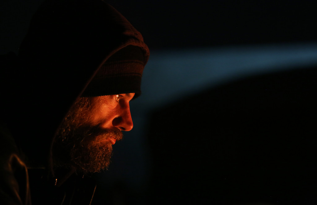 Jeff Kelly sits by the fire to warm up on Thursday November 19, 2015 at Camp Bravo in Tucson, Ariz. Kelly says he's been living at the camp for a week. Veterans on Patrol runs the camp. It was created by a group of veterans to help homeless people, particularly homeless veterans and women and children. The group has set up army tents on private property and has many items like food, clothing and water donated to them. Mamta Popat / Arizona Daily Star