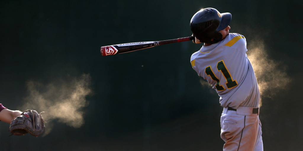 Canyon del Oro's Nate Soriano (11) takes a big swing but comes up empty in the fifth inning against Salpointe in the first game of the DII state quarterfinals at Amphitheater High School, Friday, May 8, 2015, Tucson, Ariz. Kelly Presnell / Arizona Daily Star