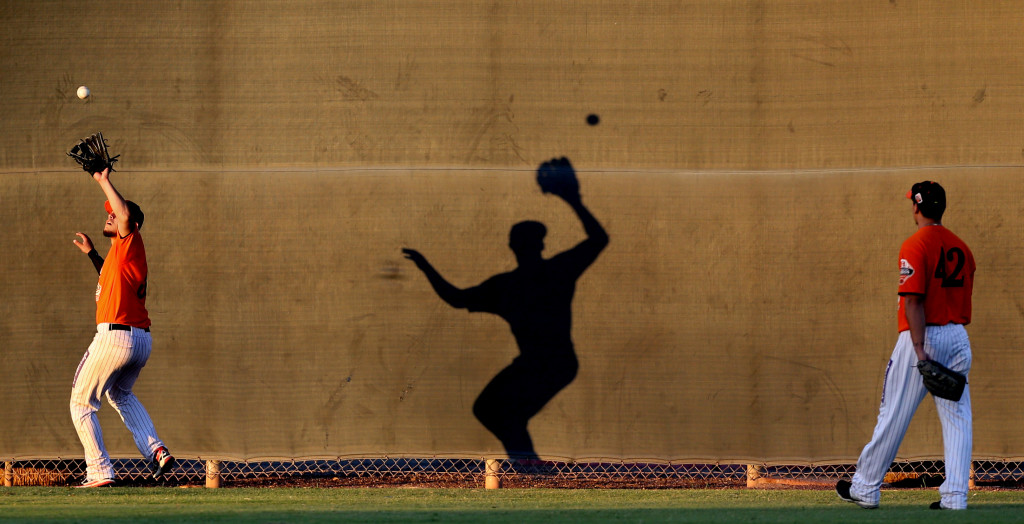 Hermosillo outfielders practice tracking down fly balls near the centerfield fence, working out at Reid Park on the Hi Corbett practice fields as they get ready for this weekend's Mexican Baseball Fiesta, Tuesday Sept. 29, 2015, Tucson, Ariz.  Kelly Presnell / Arizona Daily Star