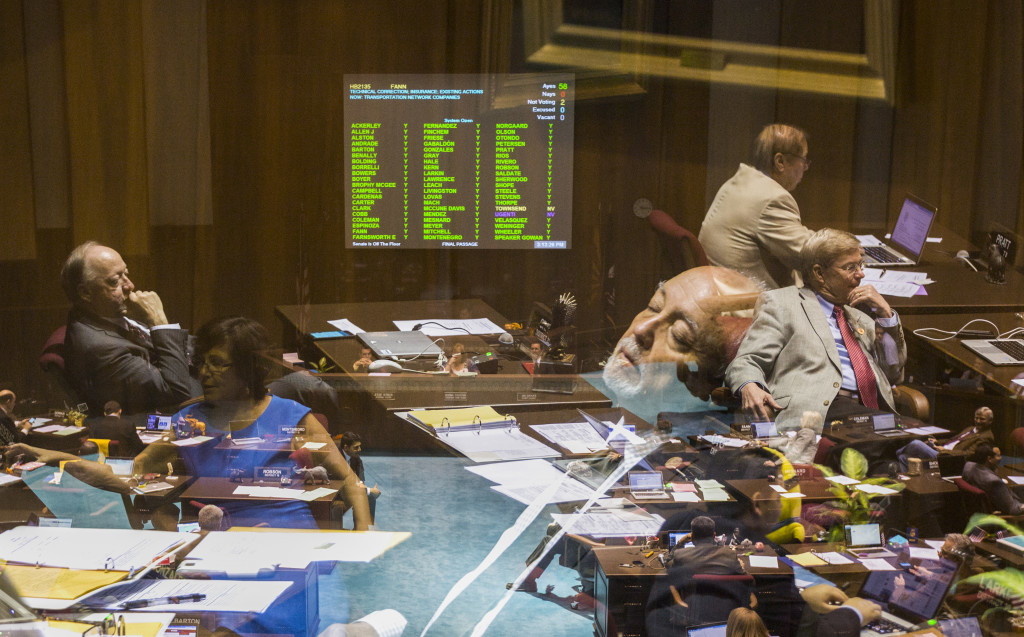 Rep. Macario Saldate leans back and closes his eyes as bills continue being discussed on the House floor on the last day of their session at the State Capitol in Phoenix, AZ on April 2, 2015.  THIS IS A COMPOSITE IMAGE MADE IN-CAMERA FROM THREE EXPOSURES.