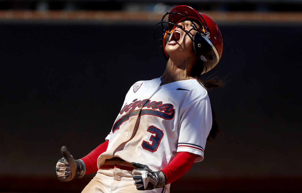Arizona's Chelsea Suitos (3) gives out a big yell after scoring the Wildcats' fifth run against Minnesota in the sixth inning of their NCAA regional game at Hillenbrand Stadium, Saturday, May 16, 2015, Tucson, Ariz. Kelly Presnell / Arizona Daily Star