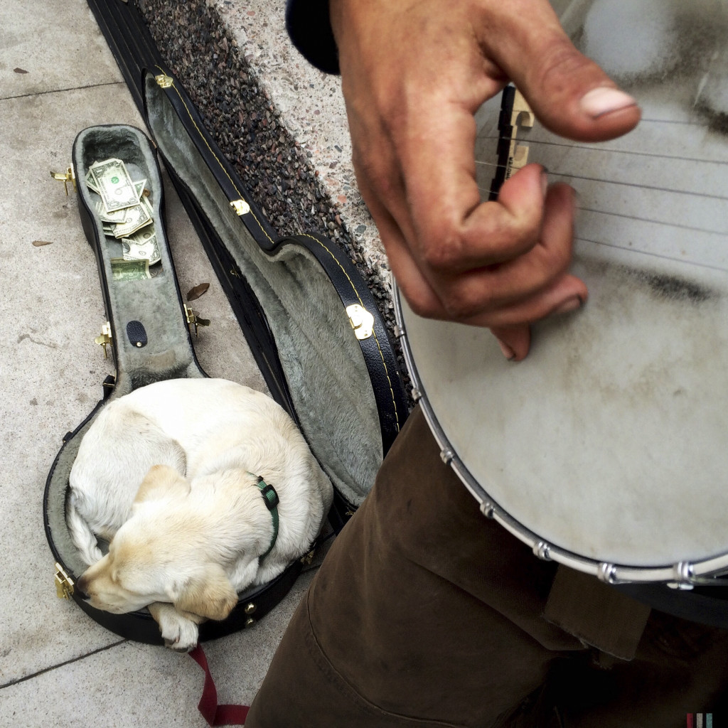 David and his dog, Nago, perform on the street, January 29, 2015, during the Super Bowl fan celebration in downtown Phoenix.