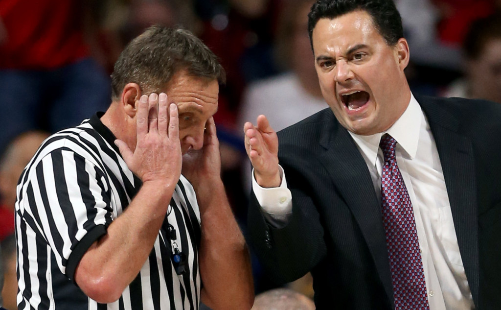 Arizona head coach Sean Miller pleads his case to referee Dave Hall after his Wildcats picked up a charging call against Boise State in the first half of their game at McKale Center, Thursday Nov. 19, 2015, Tucson, Ariz.  Kelly Presnell / Arizona Daily Star